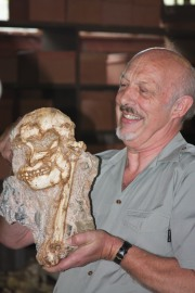 "alt=""Dr. Ron Clarke with his 1994-1998 find, 'Australopithecus,' (or ""Little Foot"") at the Sterkfontein Caves in South Africa"""