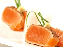 "alt=""Seared salmon with seeds and green garnish"""