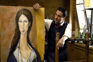 Andy Garcia as Amedeo Modigliani holding a portrait of his muse and great love, Jeanne Hébuterne