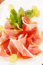 "alt=""shaved prosciutto with green garnish"""