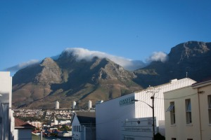 Cape Town's 'Table Top Mountain' surrounded by rising clouds in the morning.