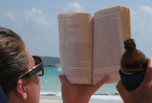 Relaxingwith a book and a beer on the beach in Jamaica