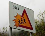 Careful, kids falling out of the sign in Slovenia!