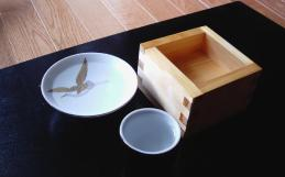 Sake can be served in a wide variety of cups; here is a sakazuki (a flat, saucer-like cup), an ochoko (a small, cylindrical cup), and a masu (a wooden, box-like cup). (Courtesy of Wikipedia)