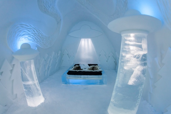 "The ""Beam Me Up!"" room at Sweden's Icehotel. Light beams, saucers, trees, but no cows!!"