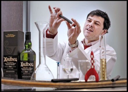 Dr Bill Lumsden, head of distilling at Ardbeg, prepares whisky vials to be taken into space. Courtesy of NASA.