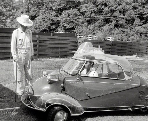 "Elvis Presley in 1956 at home in Memphis with his three-wheeled Messerschmitt ""bubble car"" and Harley-Davidson motorcycle, and grandfather Jessie Presley."