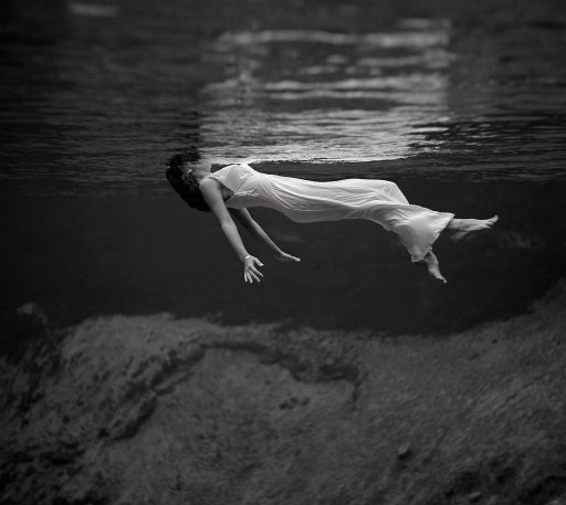A model floating in the water at Weeki Wachee Spring, Florida. The image by fashion photographer Toni Frissell was published in Harper's Bazaar in December 1947.
