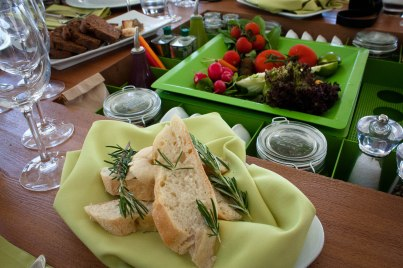 Bread with rosemary and fresh produce welcome sophisticated eaters at the annual gourmet food festival in Halkidiki, Greece.