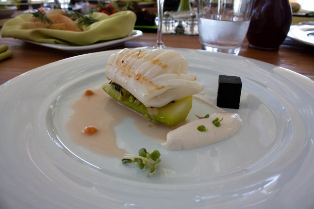 Squid on a preserved cucumber, taramosalata, stuffed courgette, and squid ink cubes.