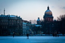 Winter Palace Square at sunset with snow, St. Petersburg, Russia.