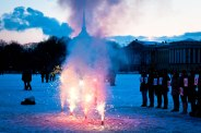 A marriage proposal with fireworks outside of St. Petersburg's Winter Palace on a winter's day at sunset.