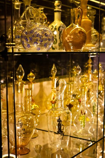 Artful glass vodka bottles at the Vodka Museum in St. Petersburg