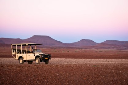 Open air jeeps take you across rugged desert terrain