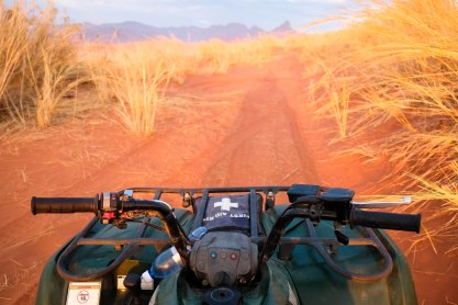 Quad biking through the sand dunes at the Namib Rand desert, Namibia (Photo by Jonathan Irish | www.jonathanirish.com/)
