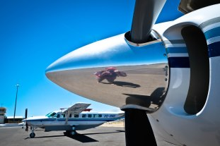 My reflection in the nose of a Cessna -- landing in Windhoek, Namibia on my birthday