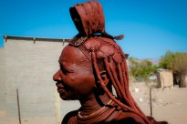 Namibian Himba woman covered themselves in red ochre as a sun protectant and natural antibacterial
