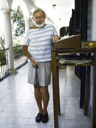 Ernest Hemingway working at his stand up desk in Malaga, Spain, a gift from his friend, Bill Davis.