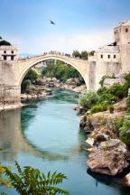 Stari Most, the old bridge of Mostar and the Neretva River that runs beneath it. Bosnia and Herzegovina.