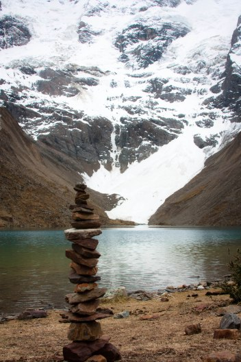 Stacking stones lakeside in the Andes