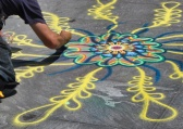 Street art made of colorful sand on the sidewalk in Washington Square Park