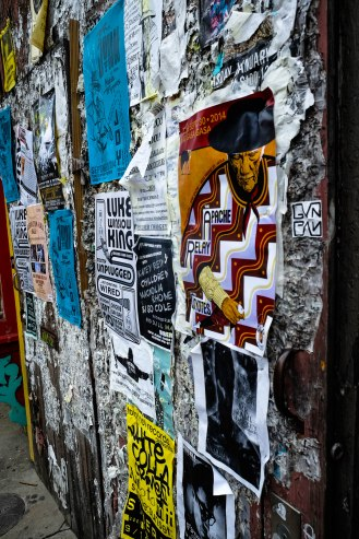 Musical act playbills tacked to a wall on Frenchman Street in New Orleans