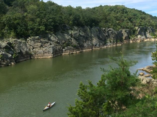 Kayaker paddles upstream on the Potomac River
