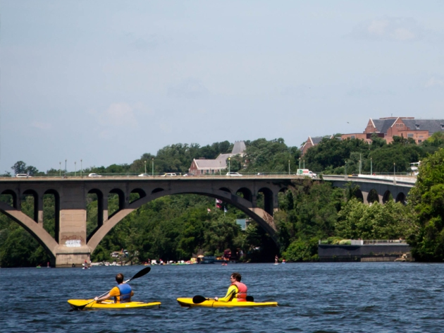 Kayakers alongside the Georgetown Waterfront near Key Bridge Boathouse
