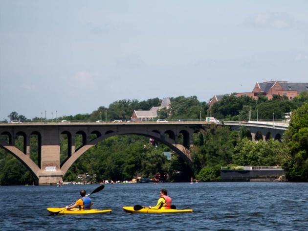 Kayakers alongside the Georgetown Waterfront near Key Bridge Boathouse