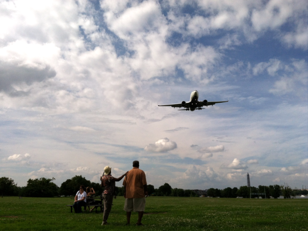 Two couples watch flights take off from Reagan National Airport at Gravelly Park (Credit: Wikimedia Common)