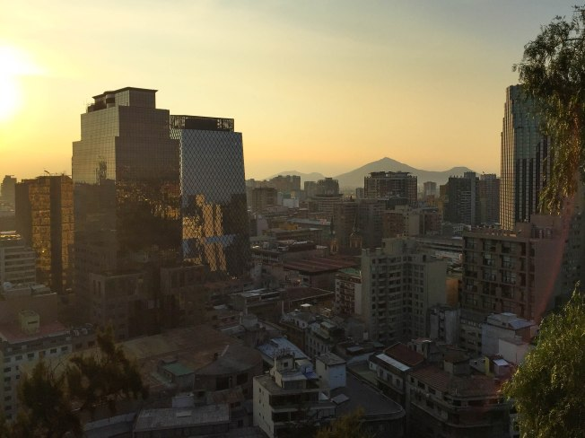 Santiago, Chile, during the golden hour at Cerro Santa Lucía with the Andes mountain range silhouette in the distance