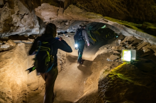 Stef follows Ranger Jackie as he leads the way into the cave. Image credit: Jonathan Irish